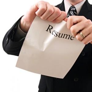 Man tearing up his CV